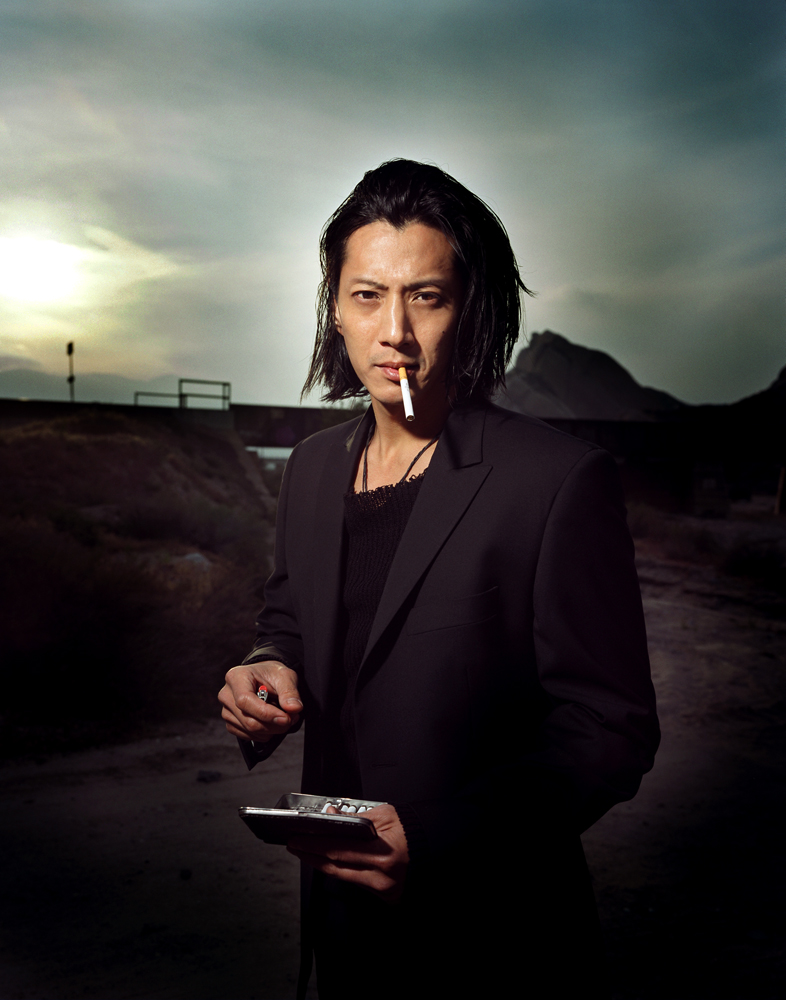 Will Yun Lee smoking a cigarette (or weed)